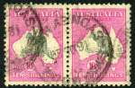 1917 10/- Grey and Deep Aniline Pink 3rd Wmk Kangaroo pair GU and very well centered. Left unit with Kangaroo's ear at left broken variety. Few shortish perfs hardly detract. ACSC 48(V)q.