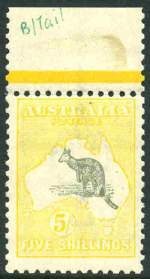 1918 5/- Grey and Pale Yellow 3rd Wmk Kangaroo MUH top marginal copy centered high. Prominent inking flaw on Kangaroo's tail.
