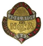 Complete set of North Adelaide Football Club badges from 1947 to 1956. (10 badges). VG condition.