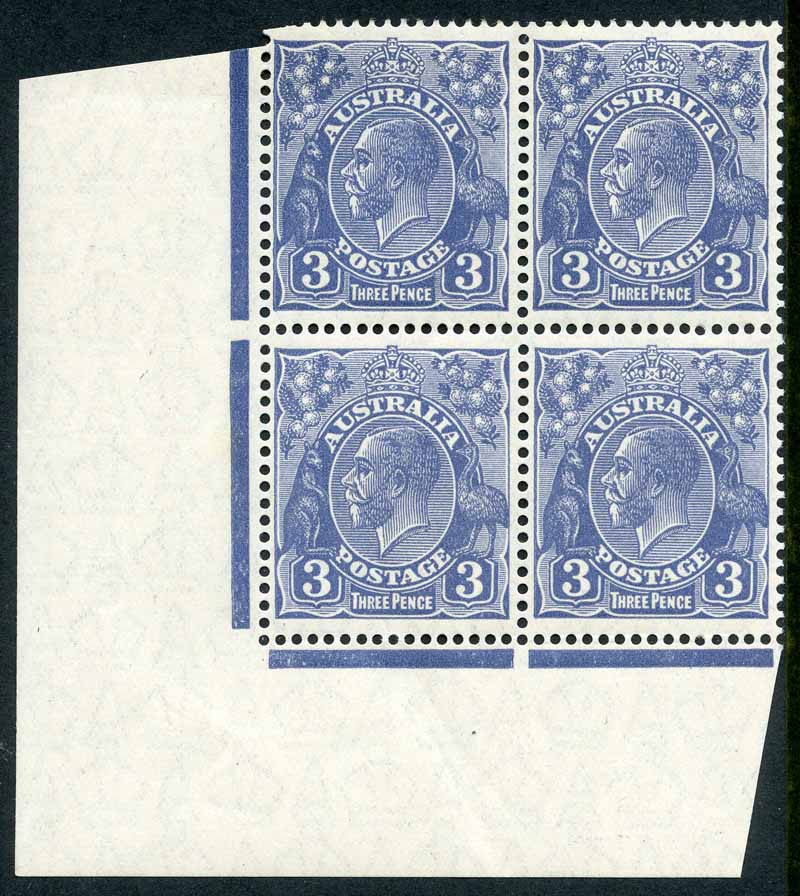 1929 3d Blue Small Multiple Wmk perf 13½ KGV MUH well centered lower left corner block of 4. Top left unit with few trimmed perfs and lightly hinged.
