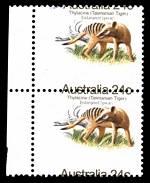 1981 24¢ Tasmanian Tiger marginal vertical pair with misplaced horizontal perforations 4mm downwards, causing perforations to run through the centre of