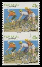 1989 41¢ Cycling vertical pair from booklet pane imperforate between CTO without gum. ACSC 1,377b.