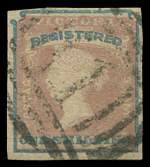 1854 1/- Rose-Pink and Blue Queen Victoria Registered stamp with 4 margins good used. Sg 34. Catalogue Value £200.00.
